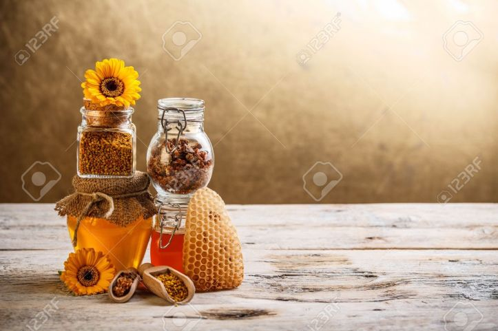 17653053-decorative-display-with-jars-of-fresh-honey-flower-pollen-and-stock-photo