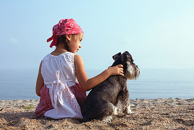 beautiful little girls embracing her dog